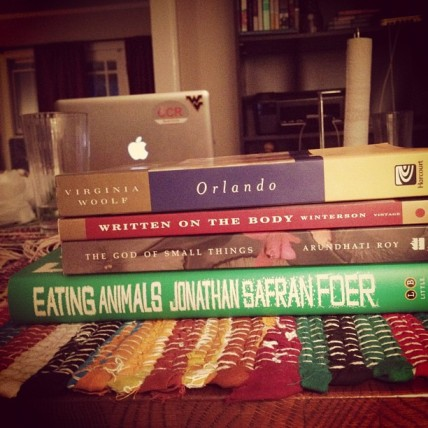 Stack of 4 for-fun books, listed below (Woolf, Winterson, Roy, and Safran Foer)